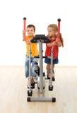 Kids having fun playing on exercise equipment Stock Photo