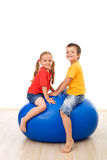 Kids having fun playing with a large ball Royalty Free Stock Photography