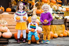 Kids having fun at pumpkin patch Royalty Free Stock Photography