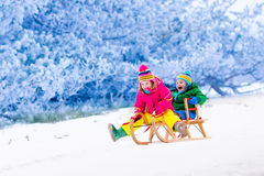 Kids having fun on sleigh ride Royalty Free Stock Image