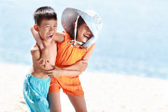 Kids having fun in sunny day stock photos