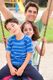 Kids having fun with their father Stock Photography