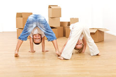 Kids having fun in their new home. Kids playing and having fun in their new home after moving in Royalty Free Stock Images