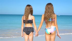 Kids having fun at tropical beach during summer vacation playing together. stock footage