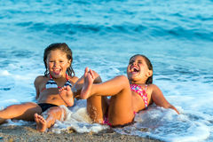 Kids having fun in waves. Royalty Free Stock Photo