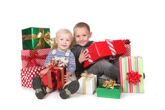 Kids Having a Good Christmas With Lots of Presents Stock Images