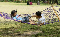 Kids having great fun in hammock Stock Photo