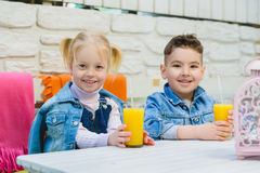 Kids having healthy breakfast. children Drinking juices and have fun Royalty Free Stock Photography
