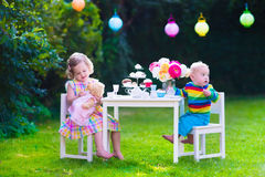 Kids having party in the garden Royalty Free Stock Images