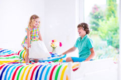 Kids having pillow fight Stock Image