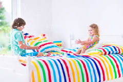 Kids having pillow fight Stock Photography