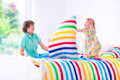Kids having pillow fight Stock Images