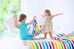Kids having pillow fight Stock Photo