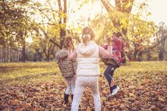 Kids having and playing together in park. stock photography
