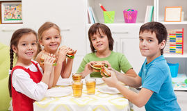 Kids having a snack in their room Stock Photos