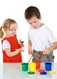 Kids having some fun with paints. Kids having some fun with different color paints - isolated Royalty Free Stock Photo