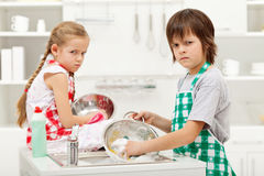 Kids having to do the dishes Royalty Free Stock Images