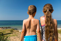Kids heading to the beach Stock Photography