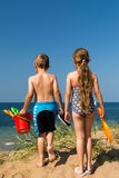 Kids heading to the beach Stock Images