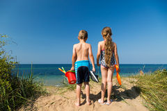 Kids heading to the beach Royalty Free Stock Photo