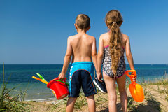 Kids heading to the beach Royalty Free Stock Images