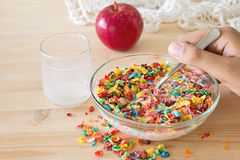 Kids healthy quick breakfast. Colorful rice cereal with milk and. Apple for kids on wooden background. Copy space royalty free stock photography