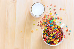 Kids healthy quick breakfast. Colorful rice cereal with milk on. Wooden background. Copy space royalty free stock images