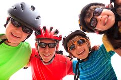 Kids with helmets. Four kids wearing helmets and pads Royalty Free Stock Photos
