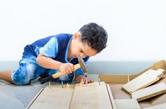 Kids help parents to assembly dining table, a piece of furniture Stock Photography