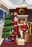 Kids Helping Parents Decorating Christmas Tree Stock Images