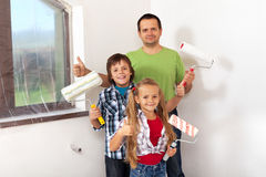 Kids helping there father painting Stock Photography