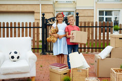 Kids Helping to Move Cardboard Boxes Royalty Free Stock Photo