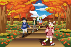 Kids Hiking in the Fall Season. A vector illustration of happy kids hiking in the fall season together Stock Image