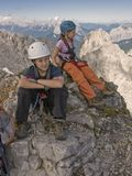 Kids hiking in mountains in Alps Stock Image