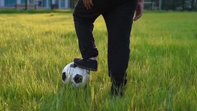 Cute boy playing football with football ball on the sunset in the park. s. stock footage