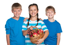 Kids hold a basket with vegetables Stock Photography