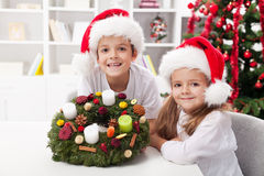 Kids holding advent wreath Royalty Free Stock Image