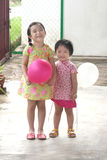 Kids holding balloons. Kids happily holding colorful balloons Stock Image