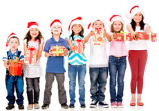Kids holding Christmas gifts Royalty Free Stock Image