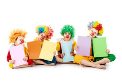 Kids holding colorful blank sheets Stock Images
