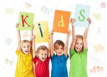 Kids holding colorful sheets with letters Stock Image