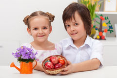 Kids holding dyed easter eggs Royalty Free Stock Photo