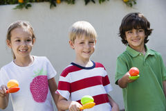 Kids Holding Eggs In Spoons For Egg Race Royalty Free Stock Image