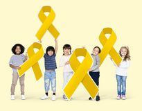 Kids holding gold ribbons supporting childhood cancer awareness royalty free stock photo