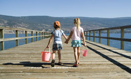 Kids holding hands. Kids walking on pier holding hands Stock Images