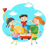 Kids holding hands around the wagon Royalty Free Stock Photo