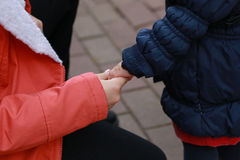 Kids holding hands in autmn Stock Photography