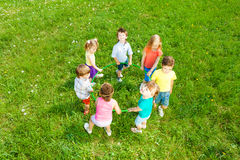 Kids holding hoop, view from top Royalty Free Stock Images