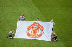 Kids holding Manchester United's Banner. Manchester United Football Club is an English professional football club, based in Old Trafford, Greater Manchester that Royalty Free Stock Photography