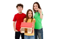 Kids holding model of house isolated on white Royalty Free Stock Images